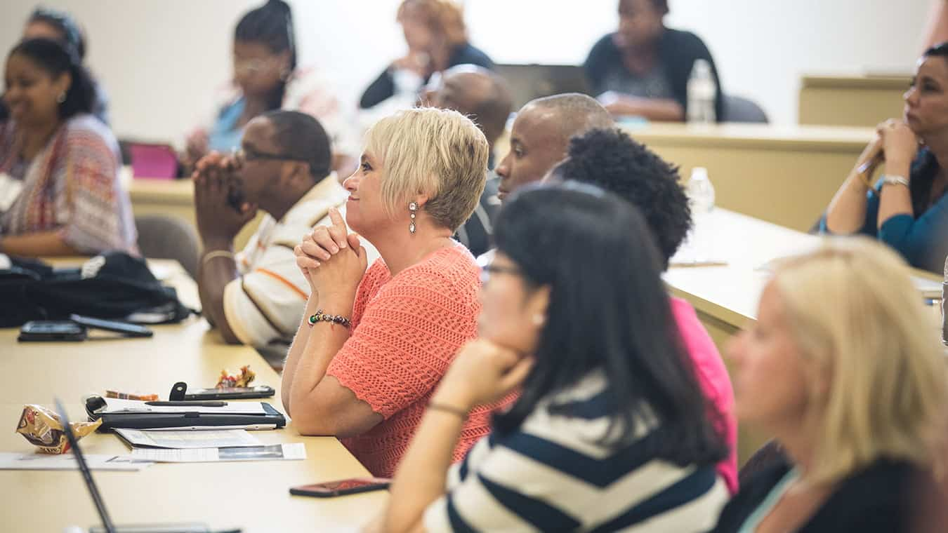 Students in a class: Explore Regent's PhD in Counseling and Psychological Studies – Trauma & Crisis Counseling program.