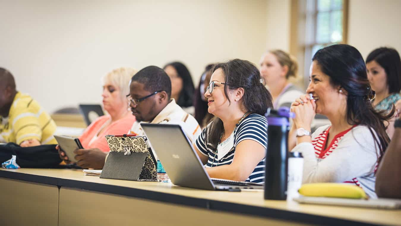 Students in class: Explore the Master's in Education - Christian School Administration program offered by Regent.