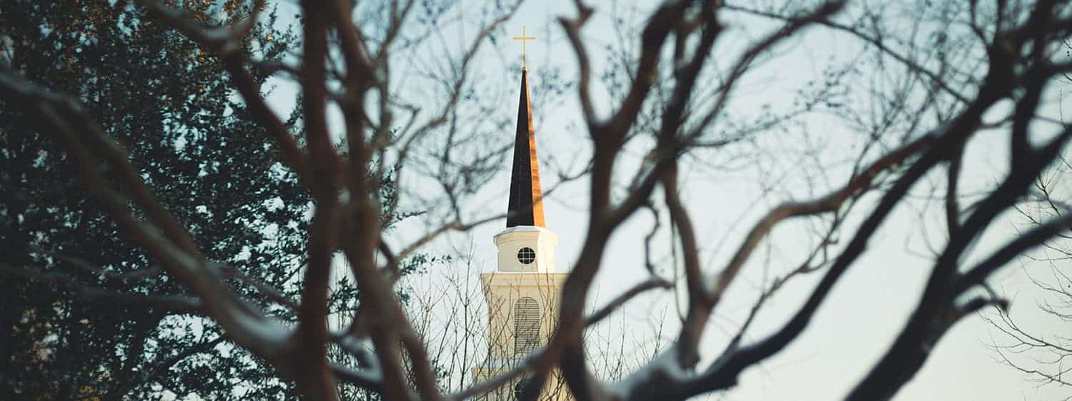 The steeple of a church: Explore Regent's MTS Church History program, offered online and in Virginia Beach, VA 23464.