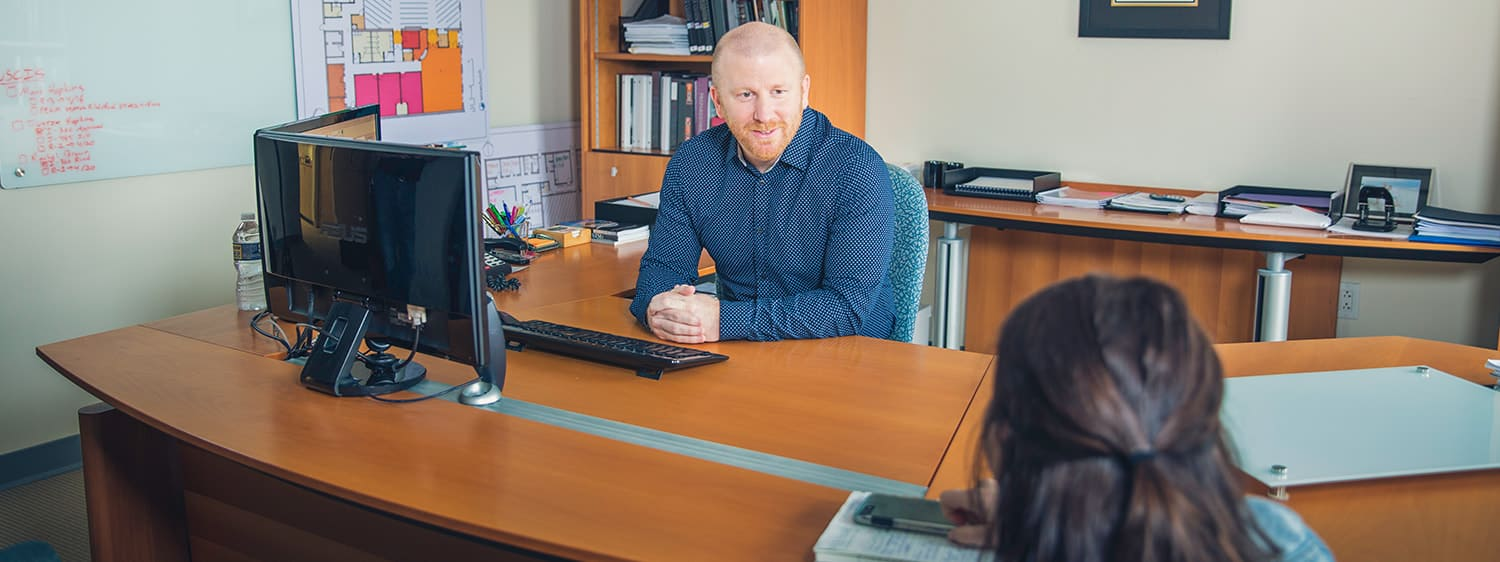 A pastor in his office: Explore the master's in pastoral counseling degree program offered online by Regent University.