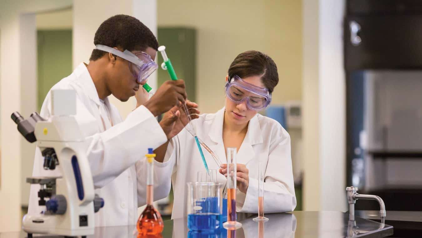 College students perform a science experiment at Regent University, Virginia Beach.
