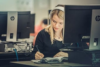 A girl studies at Regent, ranked among the Top 5% Most Affordable Private Christian Universities, 2018.
