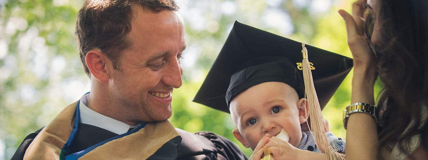 A Regent University graduate with his family on commencement day.