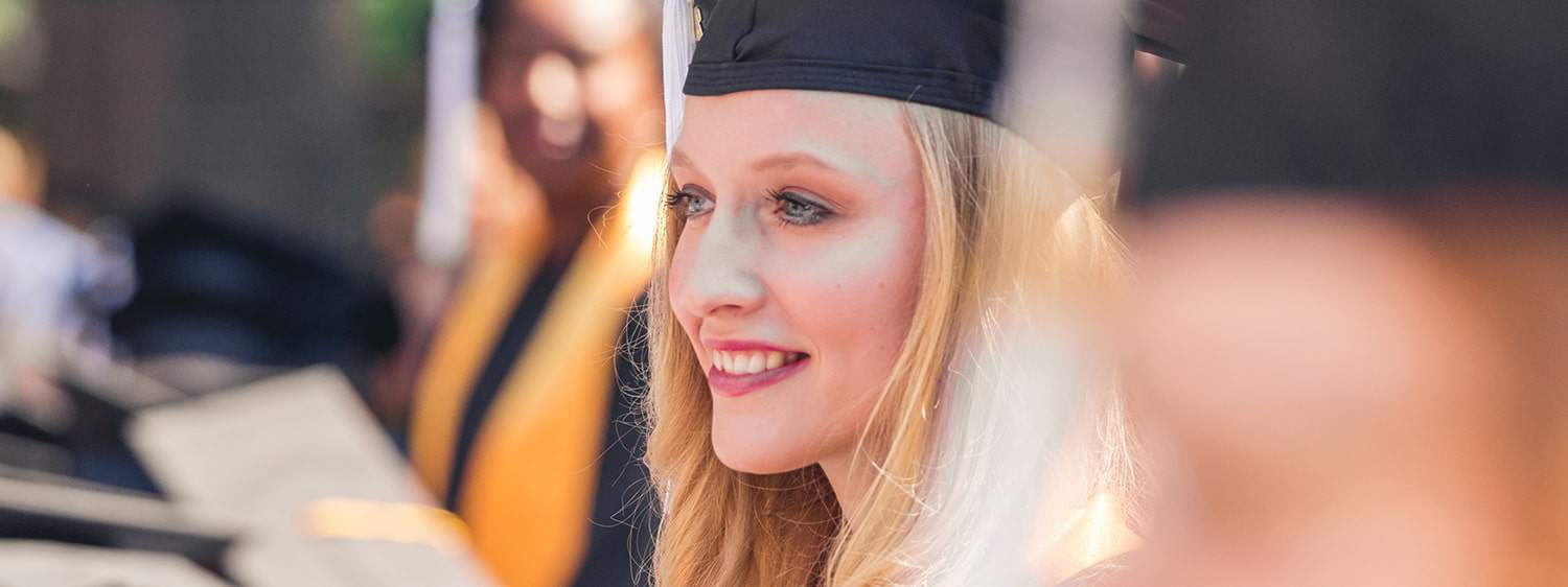 Regent University College of Arts & Sciences graduating student during a commissioning service.