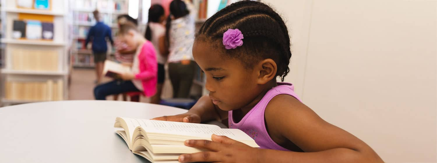 A child studying in a classroom.