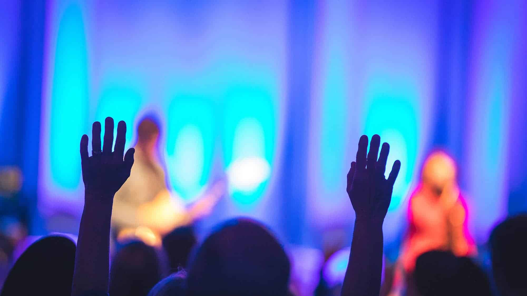 Hands raised during a Night of Worship, which offers an incoming freshman the opportunity to worship in a community.